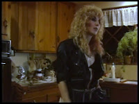 Screen shot from BOARDINGHOUSE (1982), shot at 20950 Ave San Luis in Woodland Hills, California