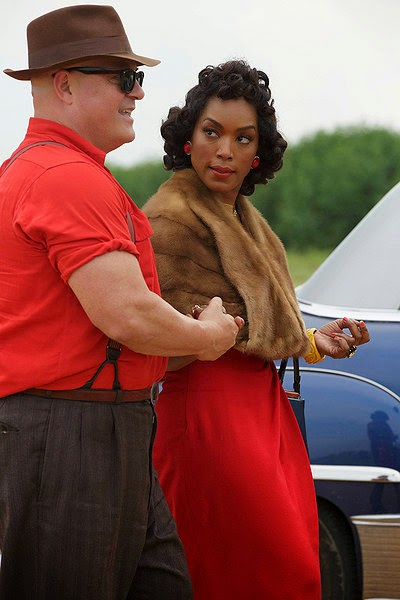 Michael Chiklis as strongman Wendell Dell Toledo with Angela Bassett as triple breasted Desiree Dupree in American Horror Story Freak Show Episode 2 Massacres and Matinees