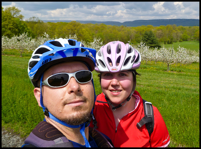 Obligatory selfie as we pass through a blooming apple orchard.