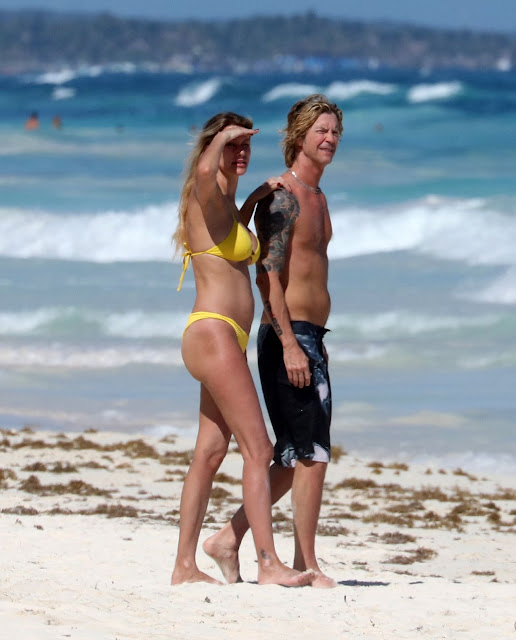 Susan Holms In Yellow Bikini and Her Husband Duff McKagan