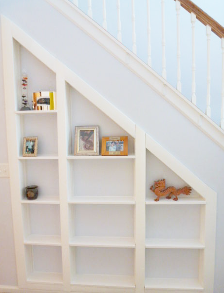 Diy home sweet home turn the area under your stairs into for Building shelves under stairs
