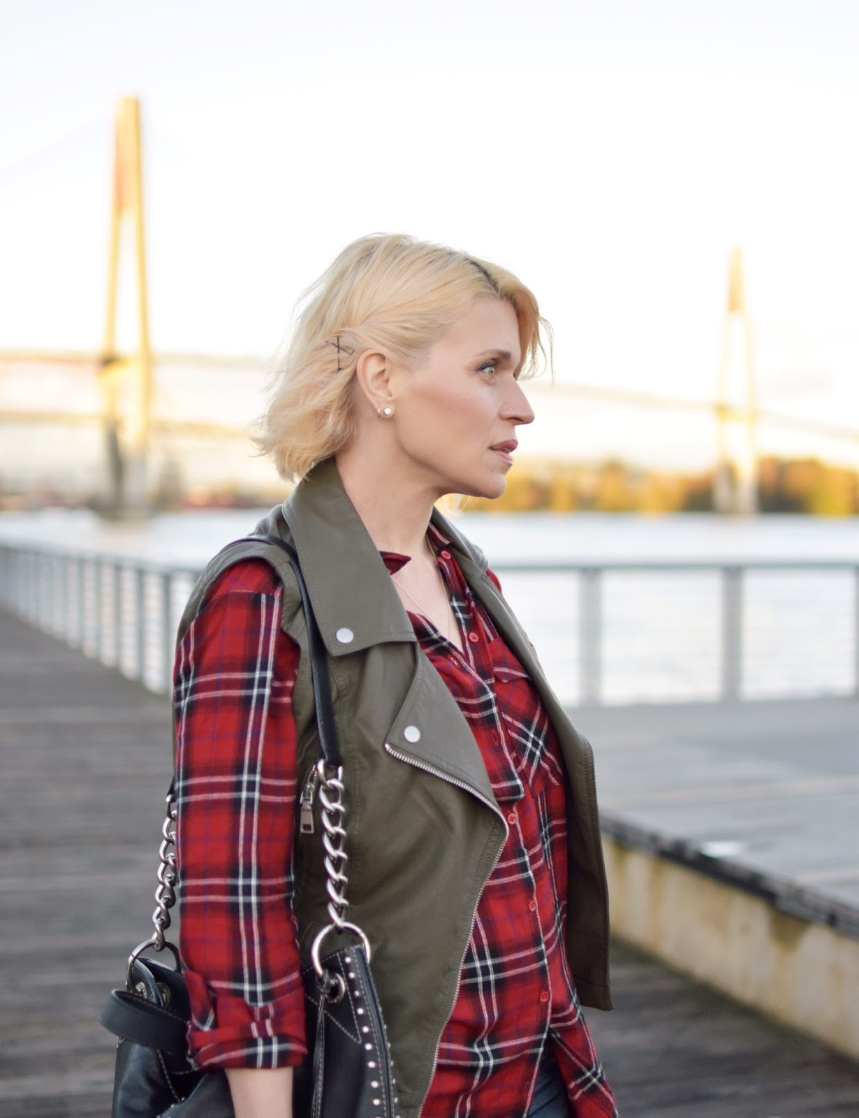 red plaid tunic, olive motorcycle vest