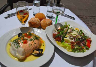 French Food Fish with Sauerkraut and Salad Strasbourg France