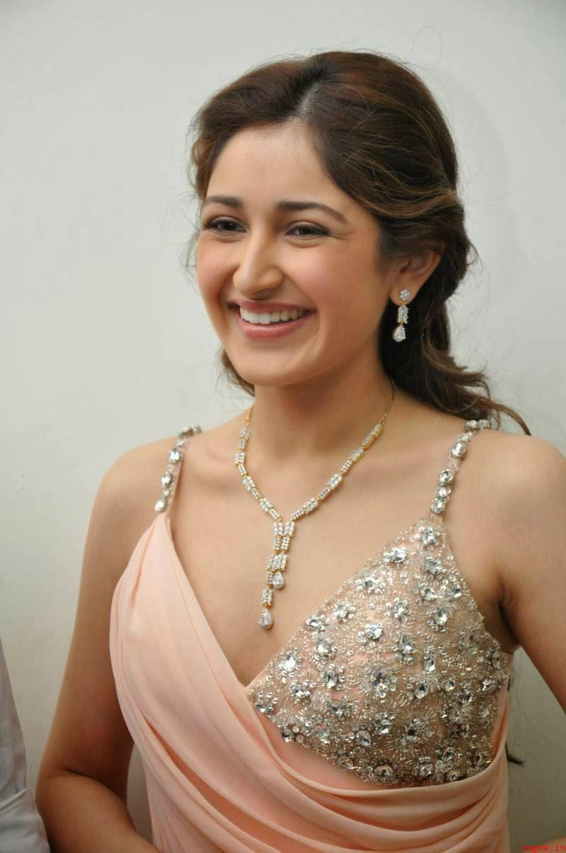 Smiling Look of Sayyeshaa Saigal - Posing in Hot Curves