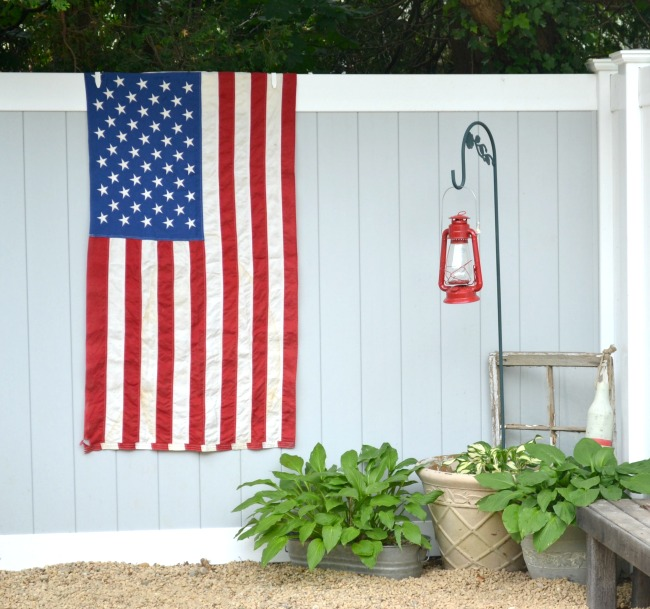 American flag hanging on the fence