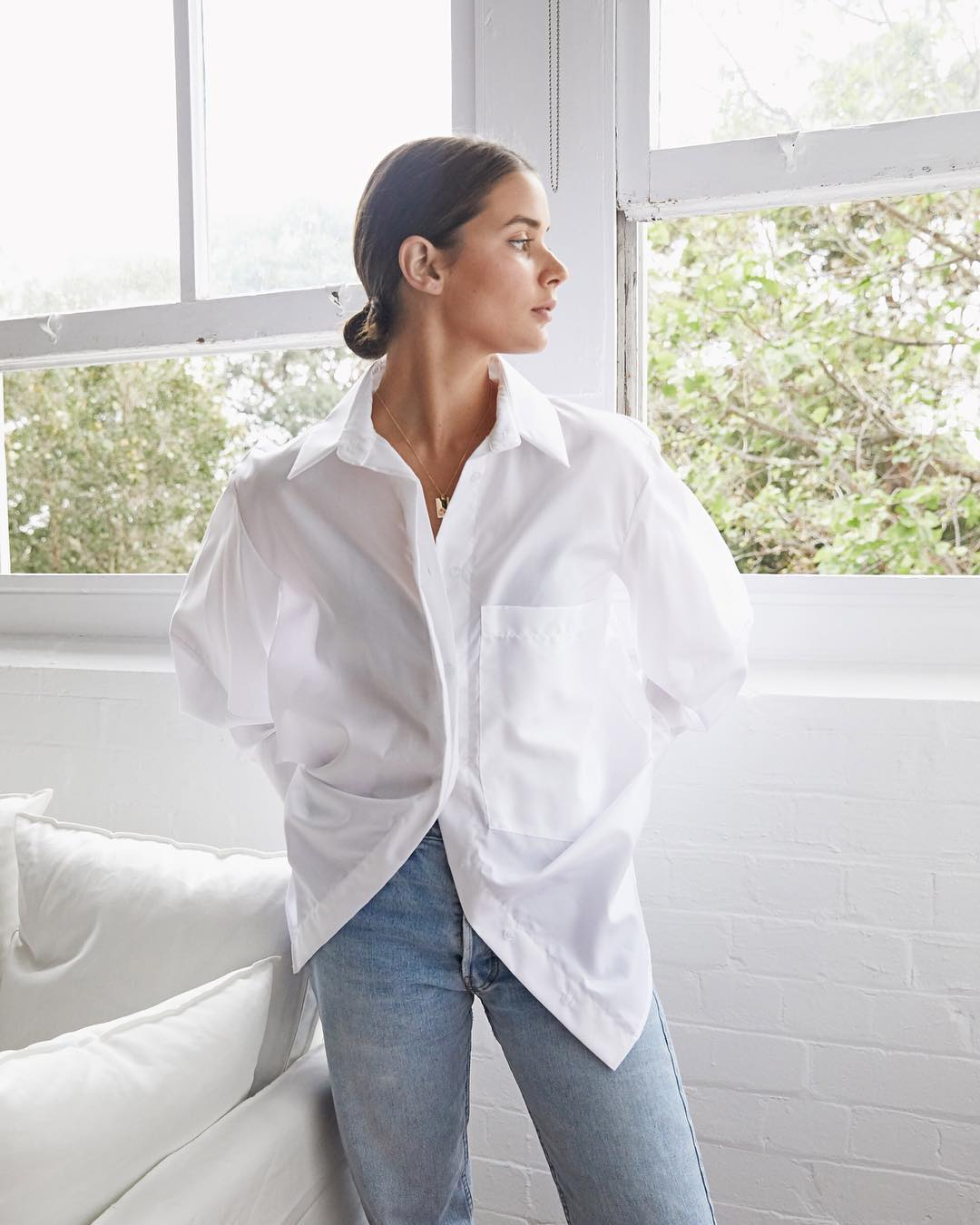 15 Crisp White Button-Down Shirts You Can Wear Year-Round — Harper & Harley with a low bun, white top, and jeans
