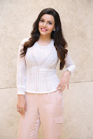 Kyra Dutt in Tight White Top Trousers at Paisa Vasool audio success meet ~  Exclusive Celebrities Galleries 031.JPG