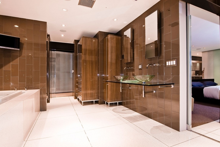 Modern brown bathroom in Hollywood Mansion by Whipple Russell Architects