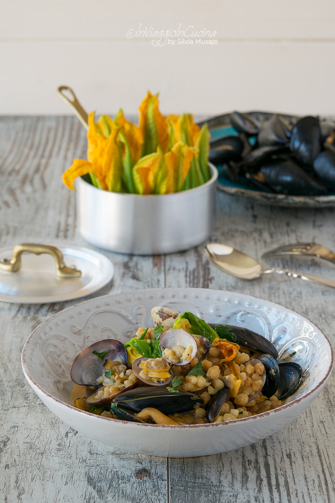 Fregola pasta with courgette flowers, mussels and clams