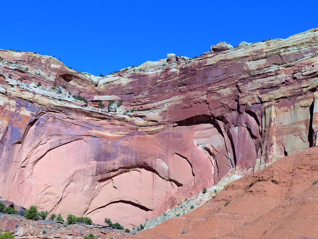 A large cliff face with some partly-formed arches.