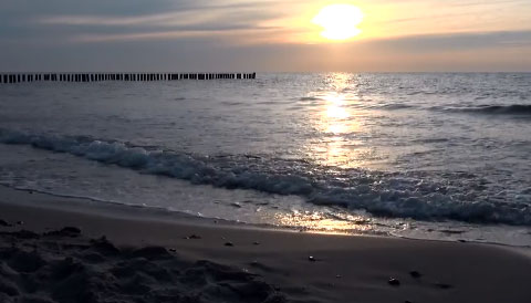 Lapping waves reflecting a beautiful sunset on a quiet beach. Set up for use with Tar Heel and switch accessibility for cause and effect use.