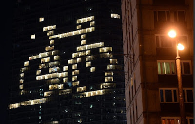 Earth Hour window lights in the shape of a bicycle