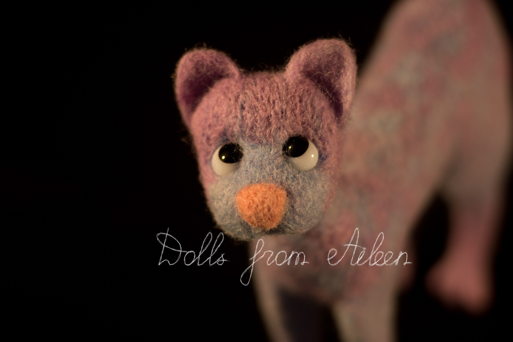 ooak needle felted cat looking into the camera
