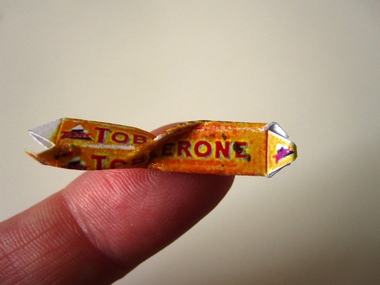 Miniature vintage empty and crumpled Toblerone chocolate package.