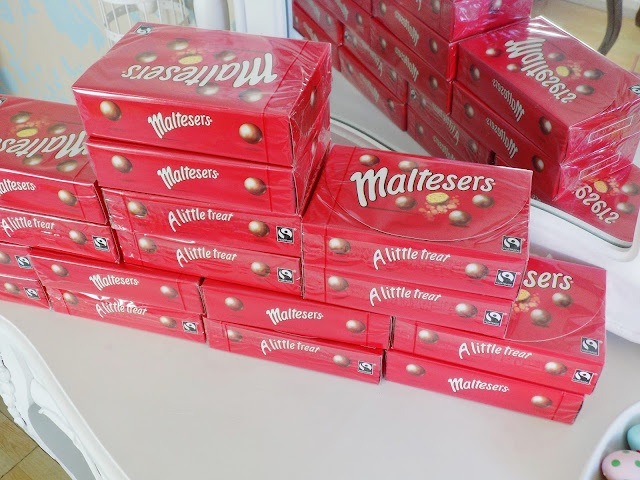 Lots of boxes of Malteasers chocolate
