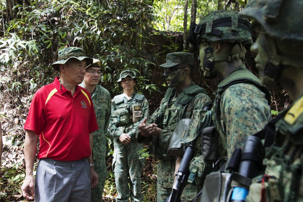 Prime Minister Lee Hsien Loong interacts with soldiers during a visit to observe jungle and survival training in Temburong. Brunei, on 06 October 2017.