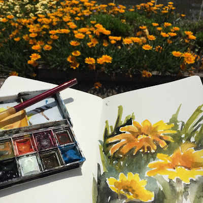 Plein air watercolour with orange flowers, sketchbook by Philine van der Vegte