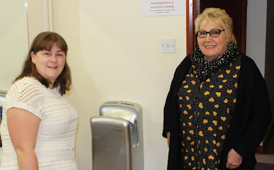 Pat Smith (left) and Nikki Gunn from Edenham Village Hall with one of the new hand dryers that has been installed at the hall.