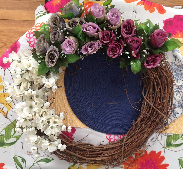 ombre florals arranged in grapevine wreath
