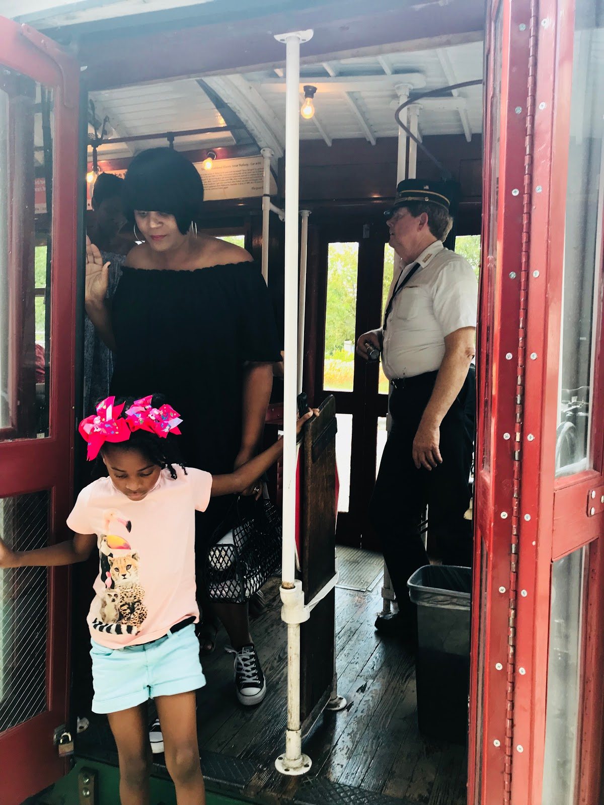 Woman and Daughter enjoying the Uptown Dallas trolley