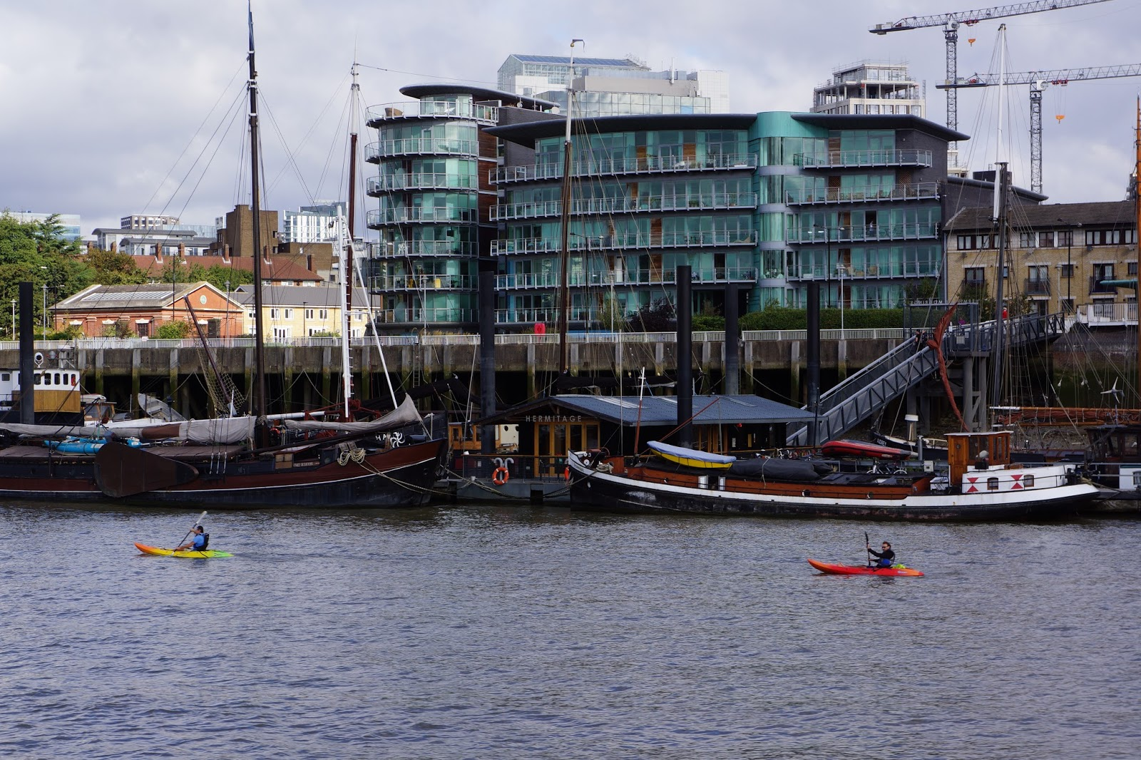 two kayakers on river thames