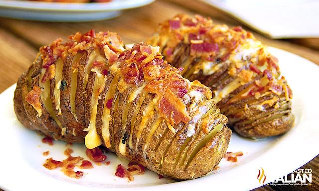 http://www.theslowroasteditalian.com/2012/07/bacon-cheddar-hasselback-potatoes.html