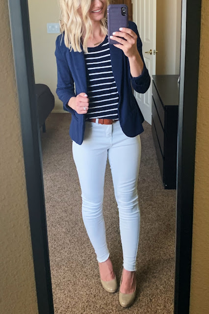 White jeans with a navy striped shirt and navy blazer