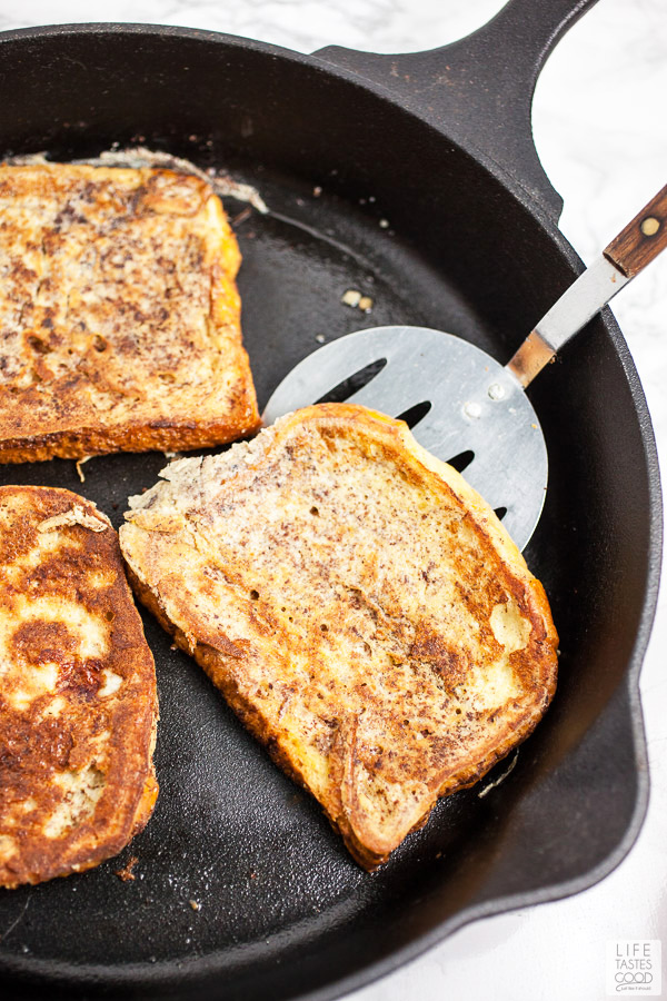 Cooking the french toast for Bananas Foster French Toast in a cast iron skillet