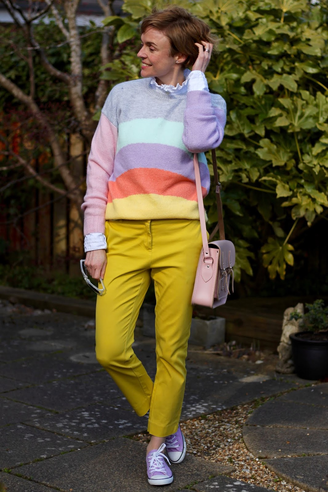 Pastel rainbow jumper and yellow trousers. Cold weather Spring outfit.