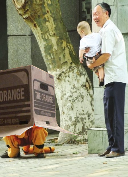 Animal escape drill in China's Chengdu Zoo 2011. A zoo employee dressed in a plush tiger costume hides under a large cardboard box. A zoo patron, holding his grandson, points out where the pretend tiger is hiding. The Zoo Houdinis and other stories. marchmatron.com
