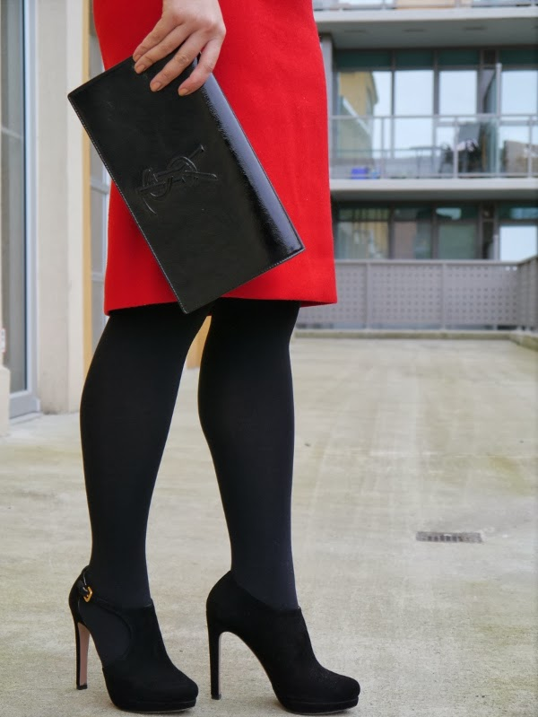 Details: Red pencil skirt, black suede Prada stiletto booties, Saint Laurent 'Belle de Jour' clutch in black patent
