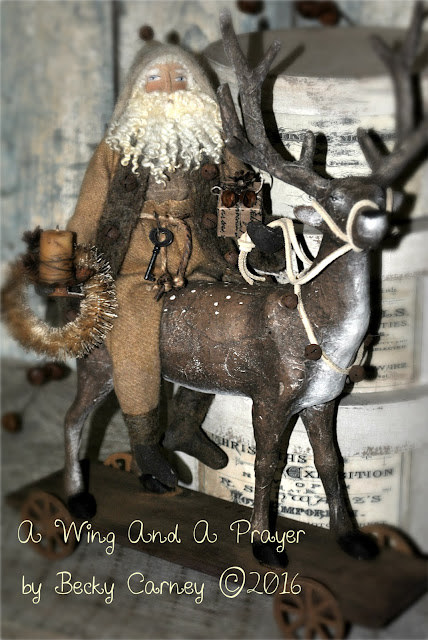 https://www.etsy.com/listing/478190830/primitive-folk-art-handmade-santa-doll?ref=shop_home_active_2