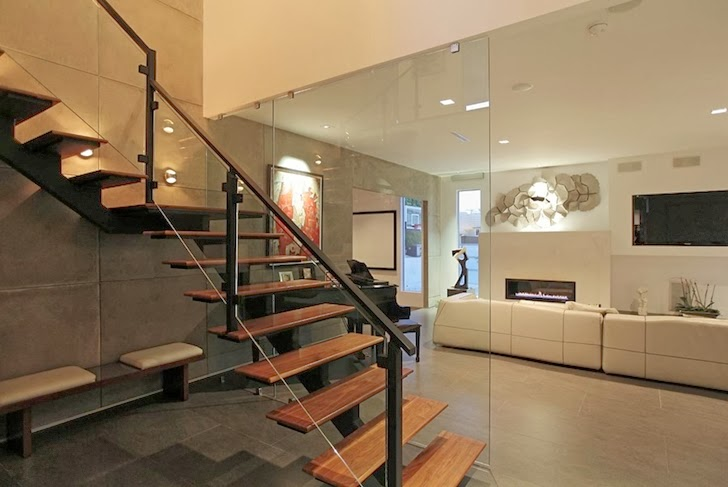 Stairs in Modern Beverly Hills House with open interiors