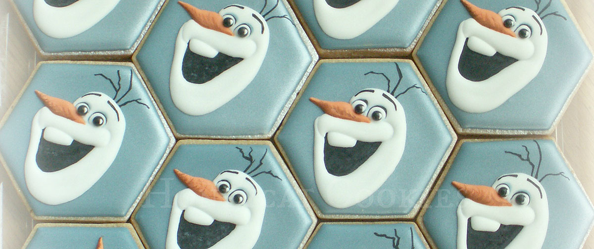 An array of decorated cookies with Olaf from Frozen, photo by Honeycat Cookies
