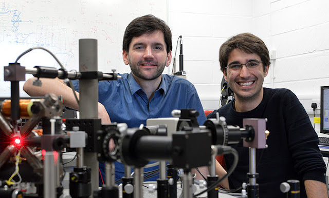 Image Attribute: Amalio Fernández-Pacheco, Principal Investigator of the project (left) and Dédalo Sanz- Hernández, lead author of the work (right) posing with the optical system used at the University of Cambridge to read information from 3D magnetic nanostructures. / Dédalo Sanz-Hernández / SINC