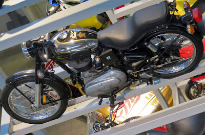 Royal Enfield Bullet motorcycle on display rack.