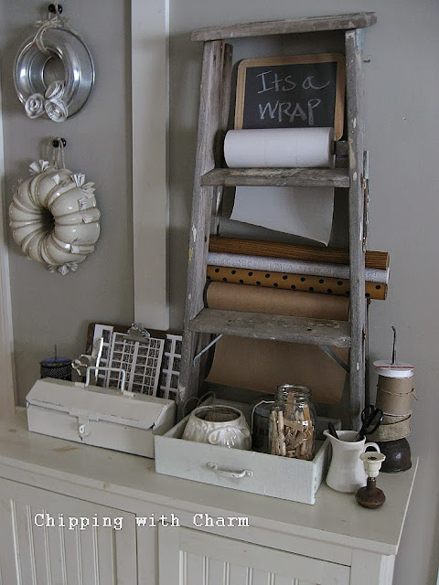 Chipping with Charm:  Getting Organized with Junk, Old Ladder turned Wrap Station...http://chippingwithcharm.blogspot.com/