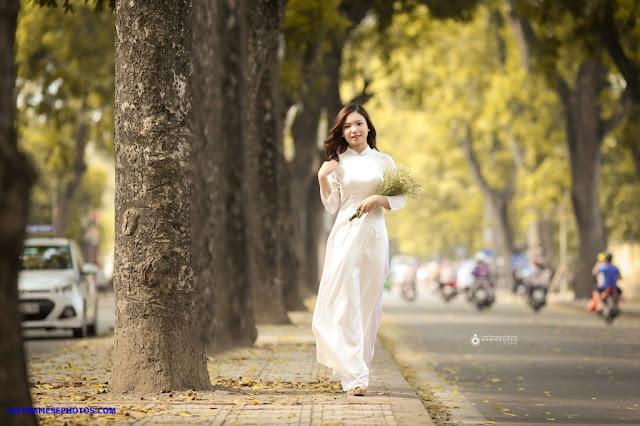 Vietnamese teen girl walking on the street with white ao da i3