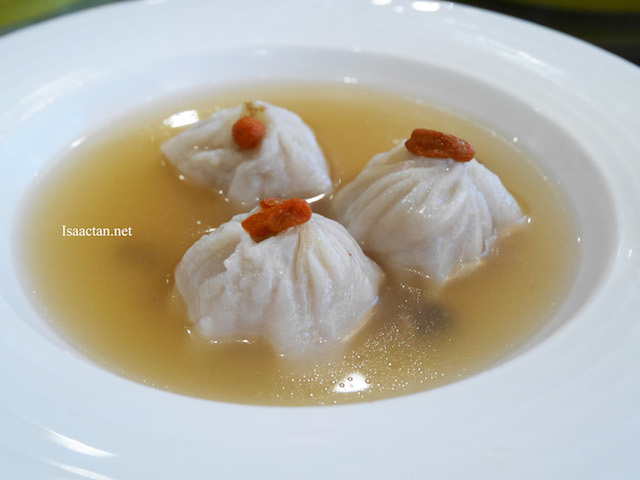 Steamed Shanghai dumpling simmered in superior stock