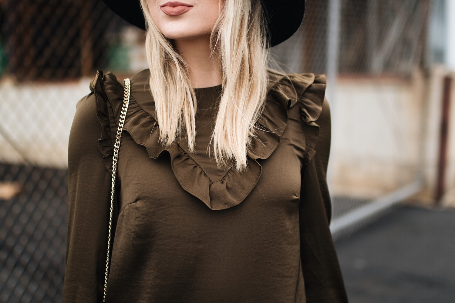 olive green ruffled top