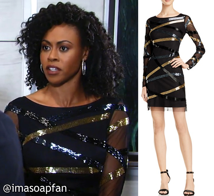 ... dressed in a black cocktail dress with sheer long sleeves and gold dfd146545