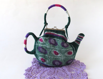 https://www.etsy.com/listing/244846017/felt-purse-felted-tea-teapot-purse-small?ref=favs_view_6&atr_uid=7871404