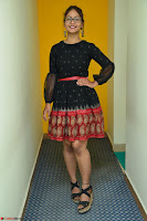 Aditi Myakal in Spicy Red Short Skirt and Transparent Black Top at at Big FM For Promotion of Movie Ami Tumi 084.JPG