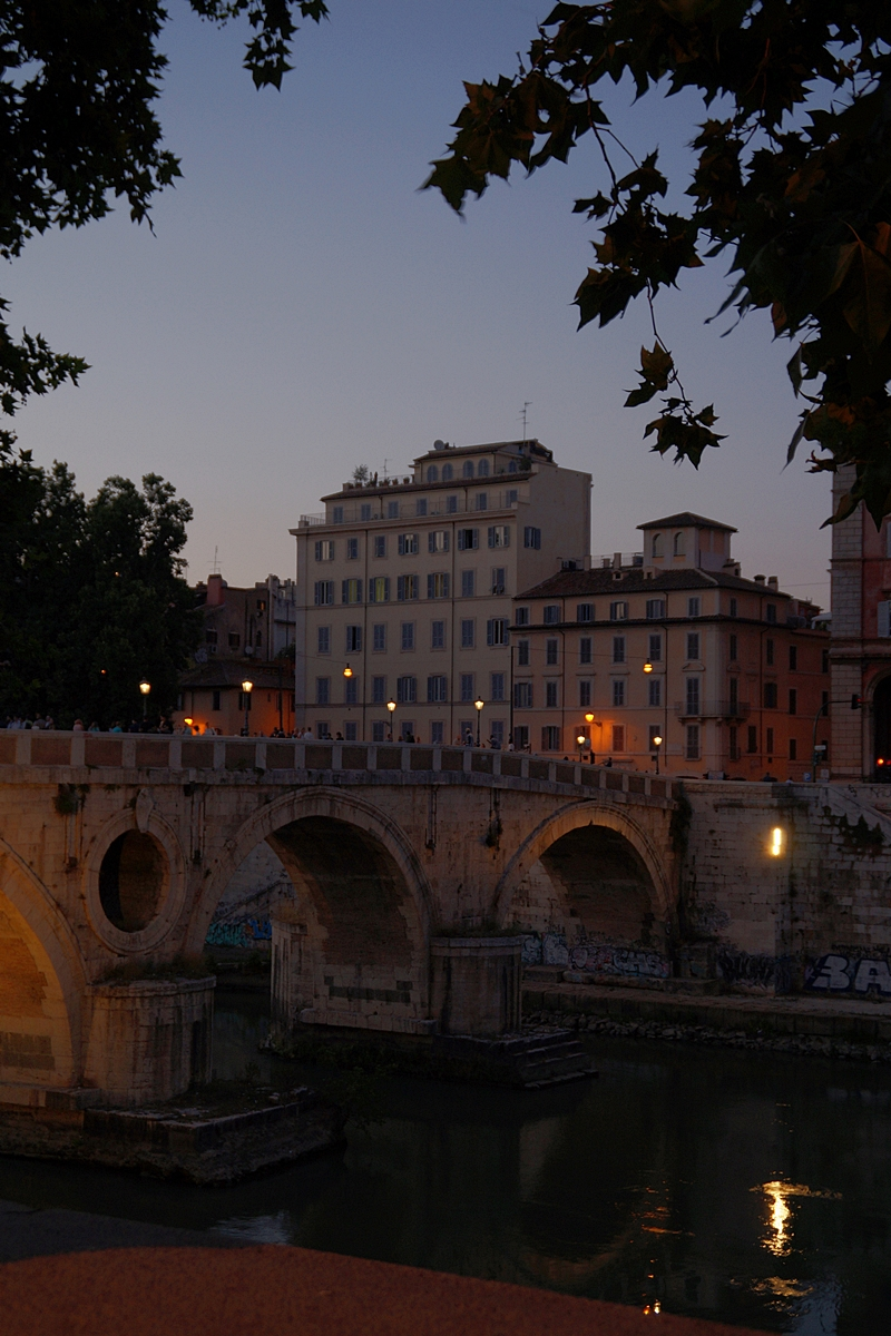 Summer night sunset at Tiber river bridge in Rome