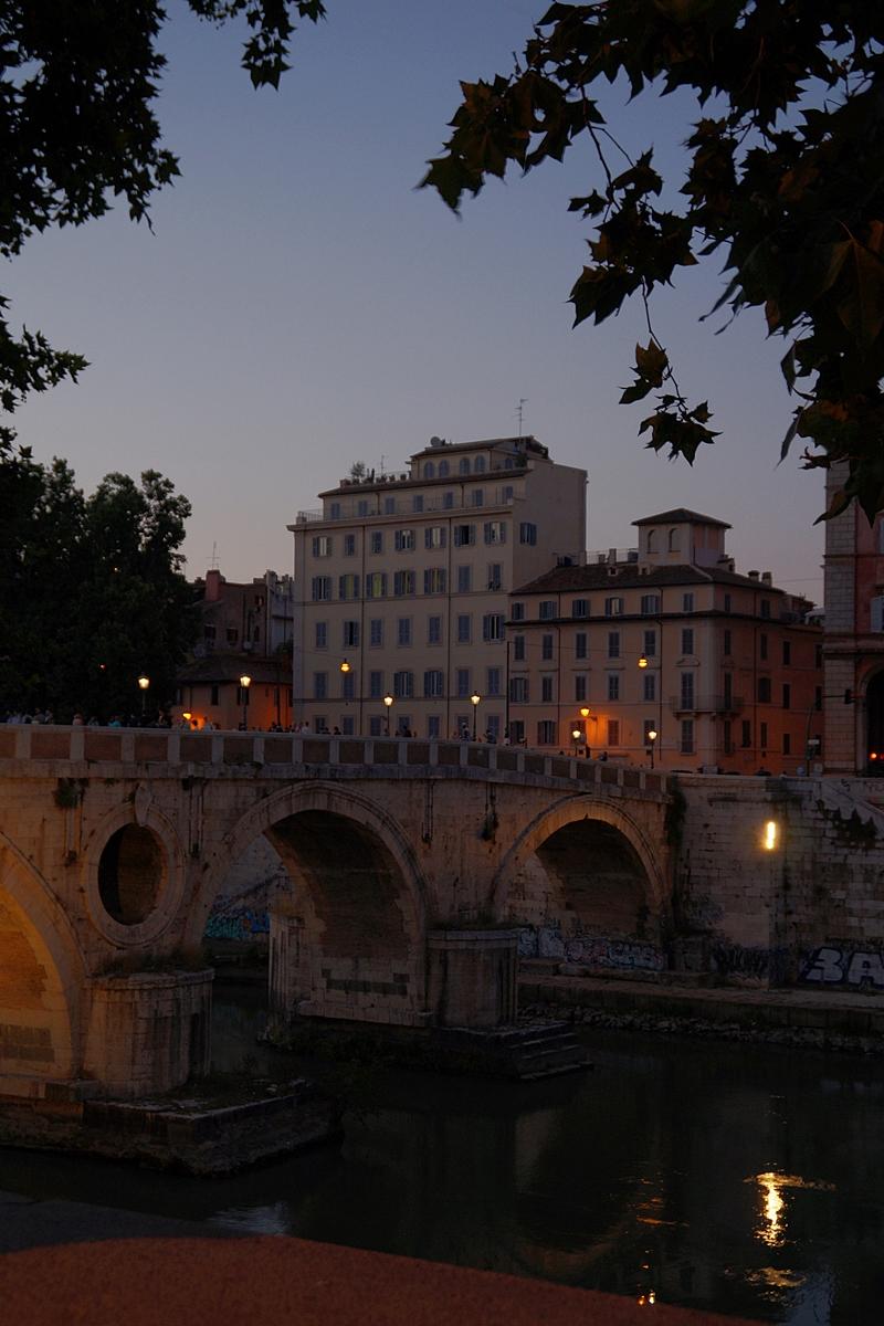 Summer night sunset at Tiber river bridge in Rome