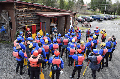A group of rafters listening to the safety speech at Adirondac Rafting Company