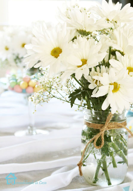 white flowers in mason jar for easter tablescape