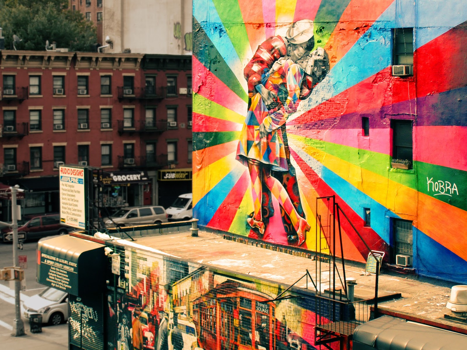 Urban mural of a sailor kissing a girl