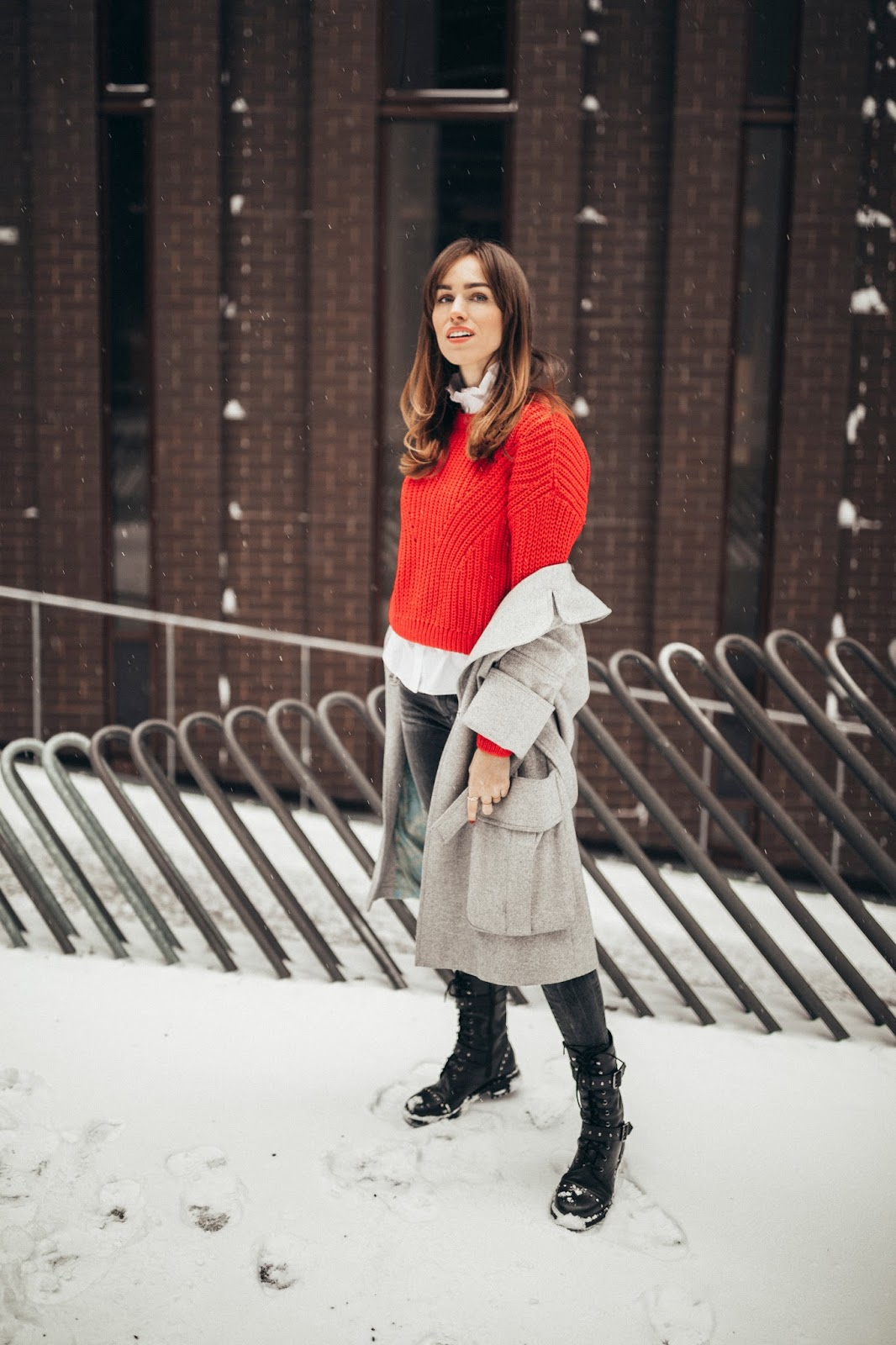red sweater grey coat combat boots outfit