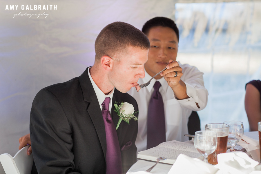 best man being fed steak while preparing toast